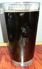 A pint of Designation Root Beer from At Large Brewing Company