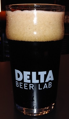 A glass of Delta Beer Lab Root Beer